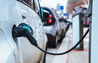 Israel bans conventional vehicle petrol gas electric vehicles compressed natural gas government charging EVs